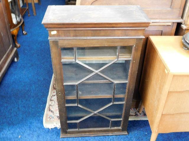 Lot 49 - A small mahogany wall cabinet