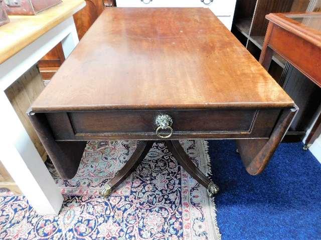 Lot 60 - A Regency period mahogany Pembroke table with bras