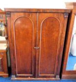 Lot 20 - A Victorian mahogany compactum wardrobe 77.25in hi