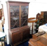 Lot 85 - A c.1900 mahogany bookcase with cupboard under