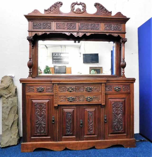 Lot 19 - A Victorian mahogany dresser with ornately framed