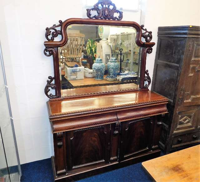 Lot 38 - A decorative mahogany chiffonier with mirror over