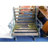 Lot 93 - A slatted cast iron garden seat
