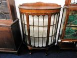 Lot 84 - A mahogany D shaped display cabinet