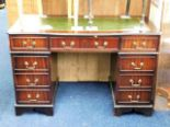 Lot 46 - A 20thC. pedestal desk with brass fittings