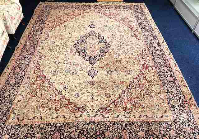 Lot 95 - A large decorative rug