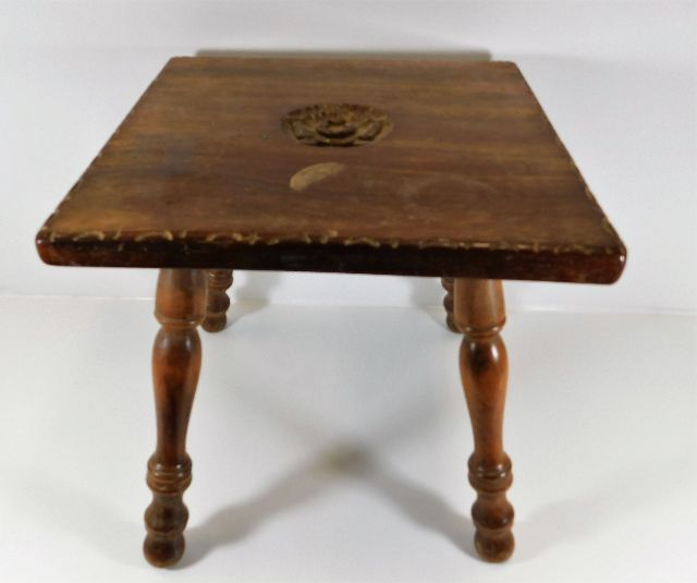 Lot 27 - A small low level table with carved rose decor sig