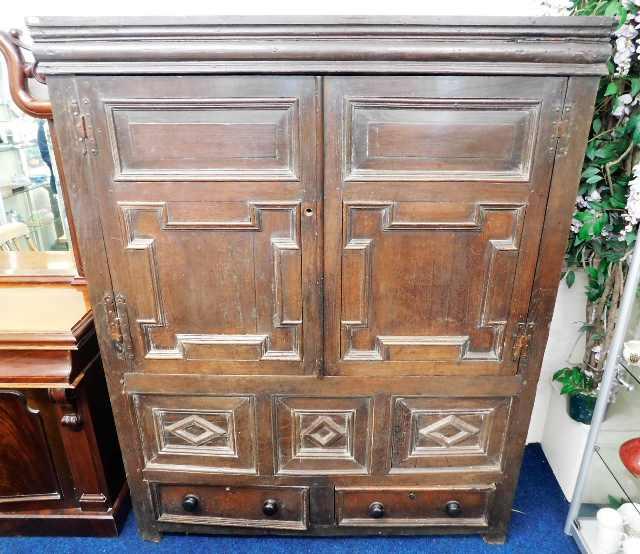 Lot 39 - A c.1650 English oak court cupboard with drawers u