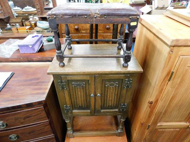 Lot 5 - A small oak Old Charm style cupboard twinned with