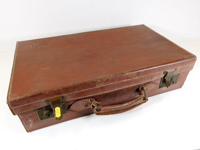 Lot 101 - A vintage leather suitcase