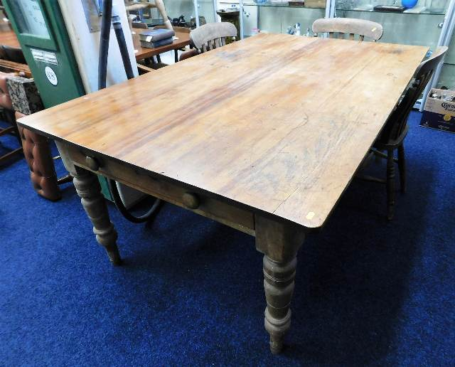 Lot 40 - A large 19thC. pine farmhouse table with two drawe