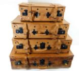Lot 109 - Four graduated leather suitcases, some faults