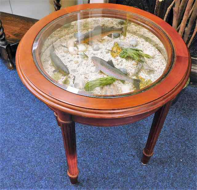 Lot 76 - A modern novelty occasional table with pond style