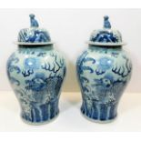 Lot 111 - A large pair of decorative Chinese lidded urns