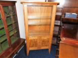 Lot 81 - A Peter Bromfield glazed display cabinet with cupb
