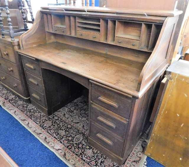 Lot 77 - A large c.1900 oak roll top desk 60in wide x 49.5i
