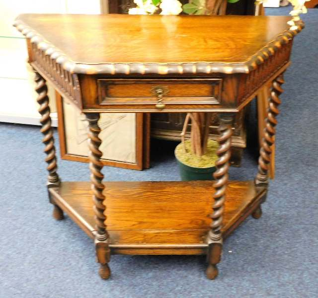 Lot 48 - An oak hall table with barley twist decor