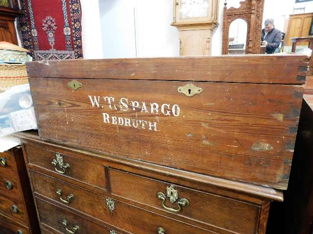 Lot 14 - An antique pitch pine chest imprinted W. T. Spargo