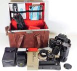 Lot 339 - A Canon A1 camera, a Canon 70-150mm lens, a Canon