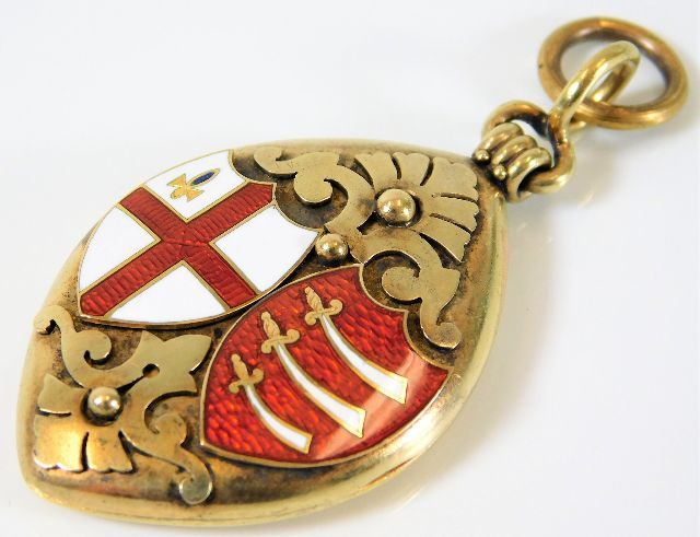 Lot 515 - A 15ct gold Victorian locket with enamelled shield
