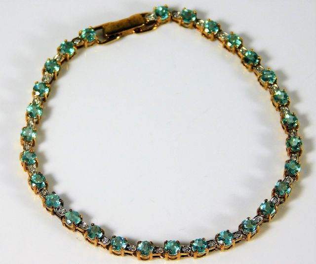 Lot 340 - A 9ct gold bracelet set with rare paraiba tourmali