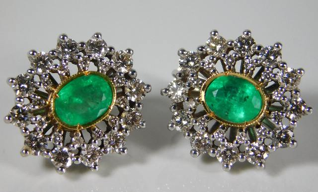 Lot 349 - A 14ct gold pair of earrings set with approx. 2ct diamond & emeralds 12.8g