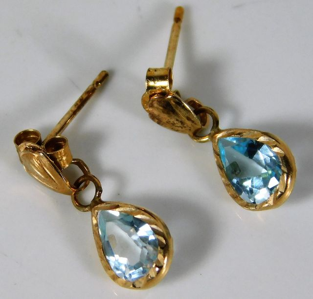Lot 355 - A pair of 9ct gold earrings set with topaz