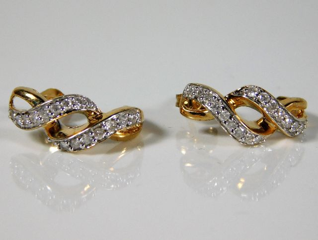 Lot 343 - A pair of 9ct gold earrings set with diamonds 2.6g