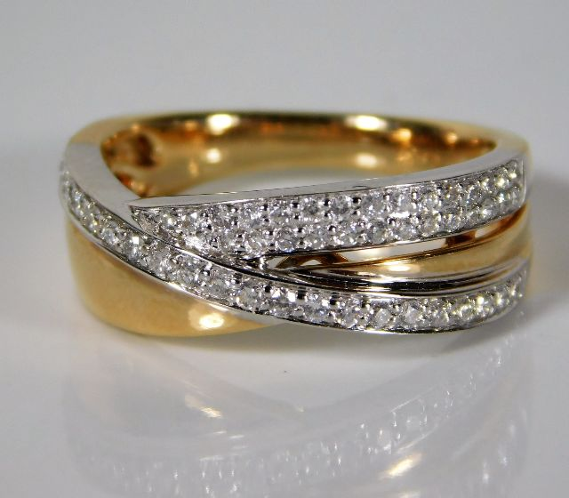 Lot 336 - A 14ct two colour gold ring set with approx. 0.36c