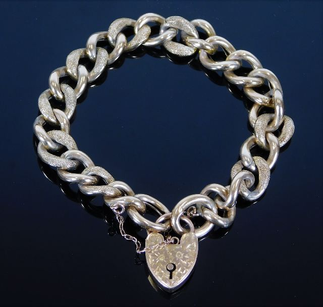 Lot 314 - A 9ct gold curb bracelet with engraved clasp 14.8g
