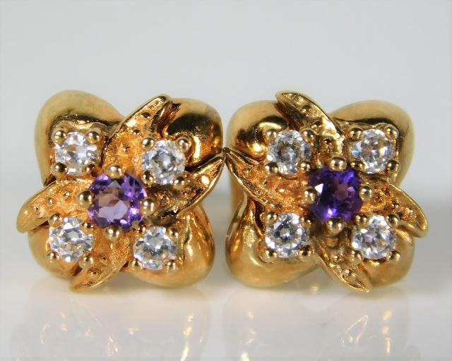 Lot 338 - A pair of 9ct gold earrings set with diamond & ame
