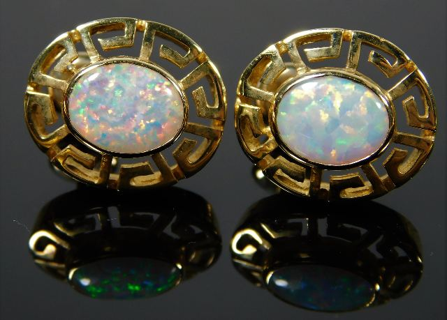 Lot 295 - A pair of 14ct gold earrings set with opal style s