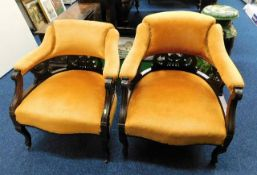 Two upholstered armchairs, one lacking wheel