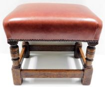 A leather topped oak footstool 15in high