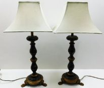 A pair of ornate wooden table lamps with shades 34
