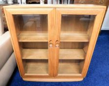 A retro Ercol elm floor standing bookcase 38in hig