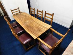 An African hardwood refectory style table top on t