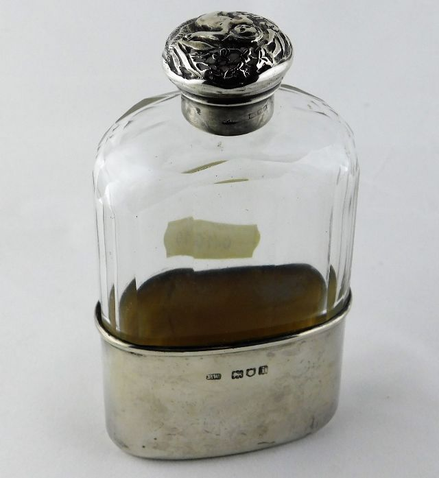 Lot 260 - A faceted glass hip flask with silver cup & silver