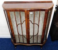 A serpentine fronted display cabinet, some faults