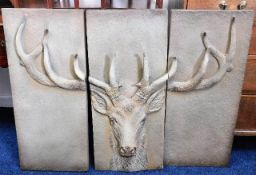 A large decorative metal triptych of stag head 41.