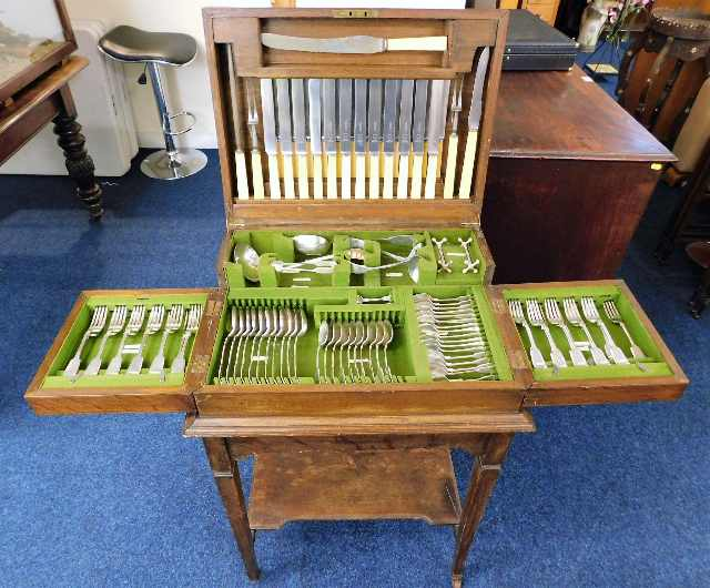 Lot 14 - An early 20thC. oak canteen with mostly silver pla
