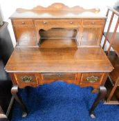 A brass fitted George III oak ladies lowboy with l