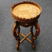 A c.1900 carved Anglo-Indian table with mother of