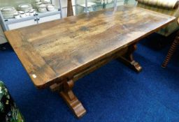 A rustic 19thC. oak farmhouse table with cleated e