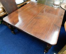 A Victorian extending mahogany dining table with l