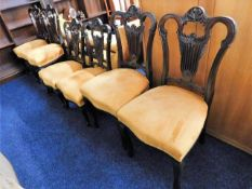 Four upholstered dining chairs twinned with two ma
