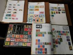 Four stamp albums comprising mixed mostly used sta