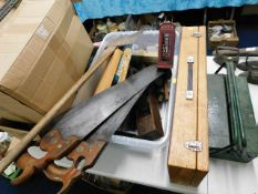 Two carpenters saws, a large axe & other tools inc