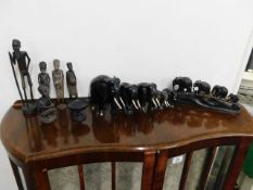 A quantity of various hardwood ethnic carvings