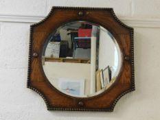 A 1920's oak framed mirror